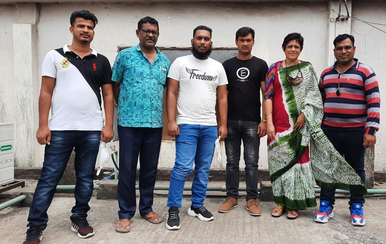 Four Bangladeshi trafficking victims who were rescued in West African country of Togo along with officials of supportive organisations pose for a photograph after their return to Bangladesh on Saturday. Photo: collected
