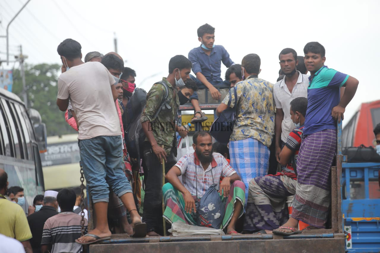 Jam-packed in a small truck. Almost none of them are seen wearing masks