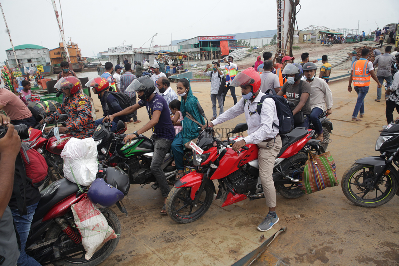 Motorcyclists get on board a ferry