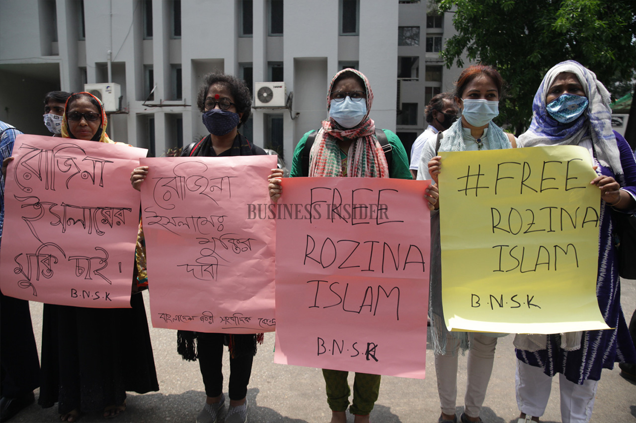 Women hold placards demanding the release of Rozina Islam