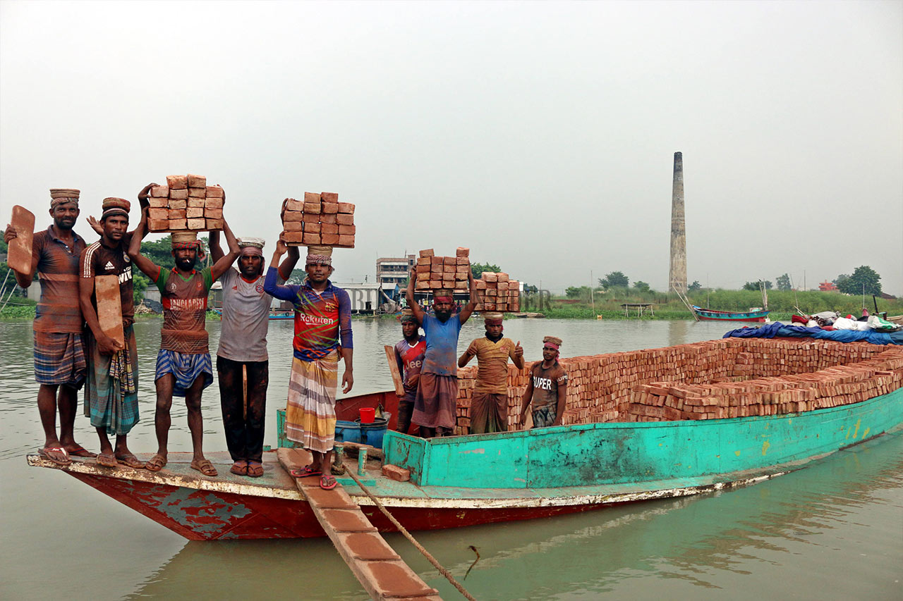 A group of brick field workers shifting bricks by boat