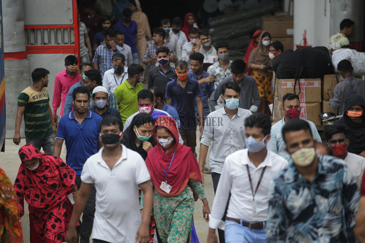 Garment workers walks out in group from a factory