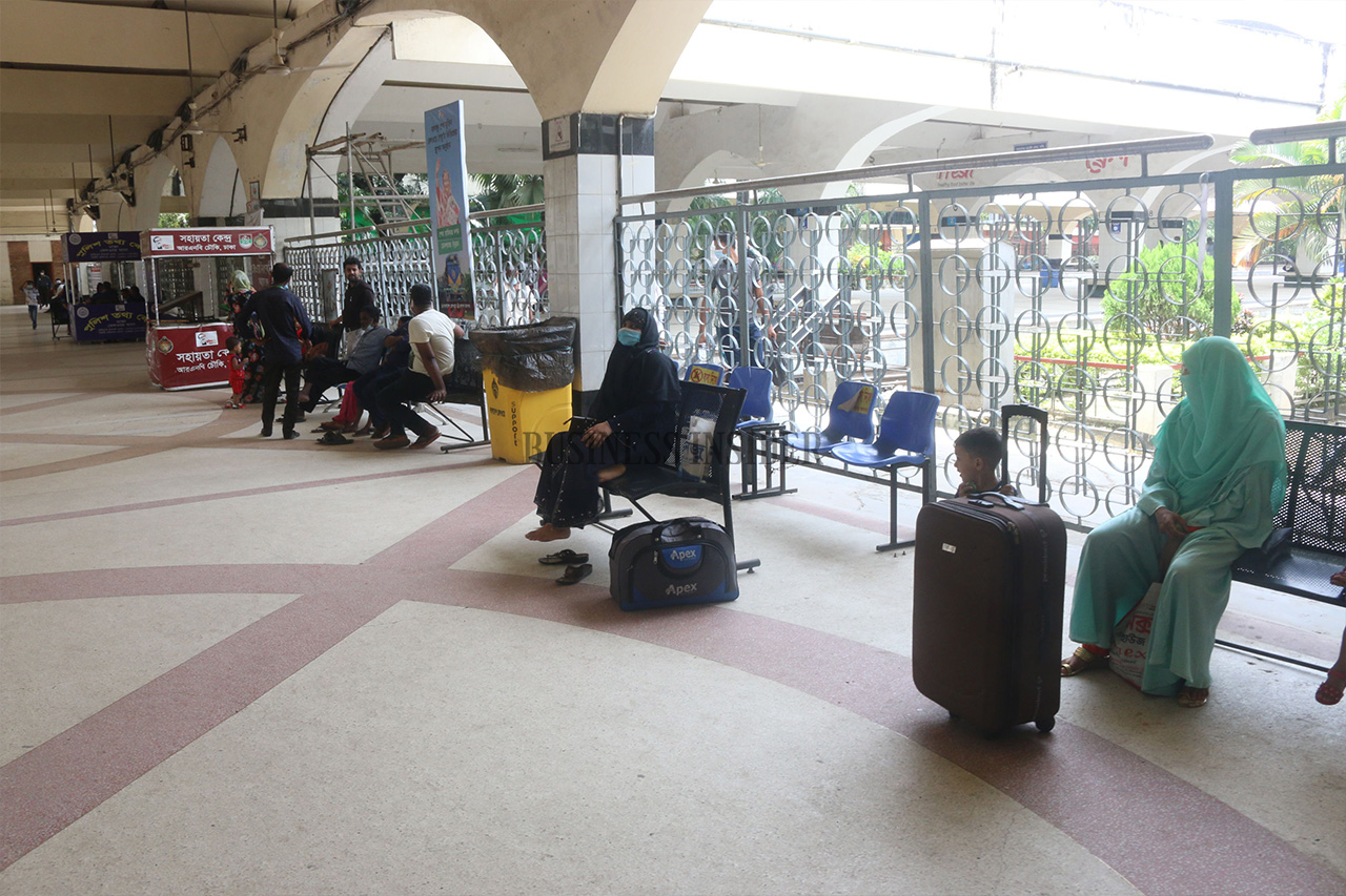 Passengers wait at the station