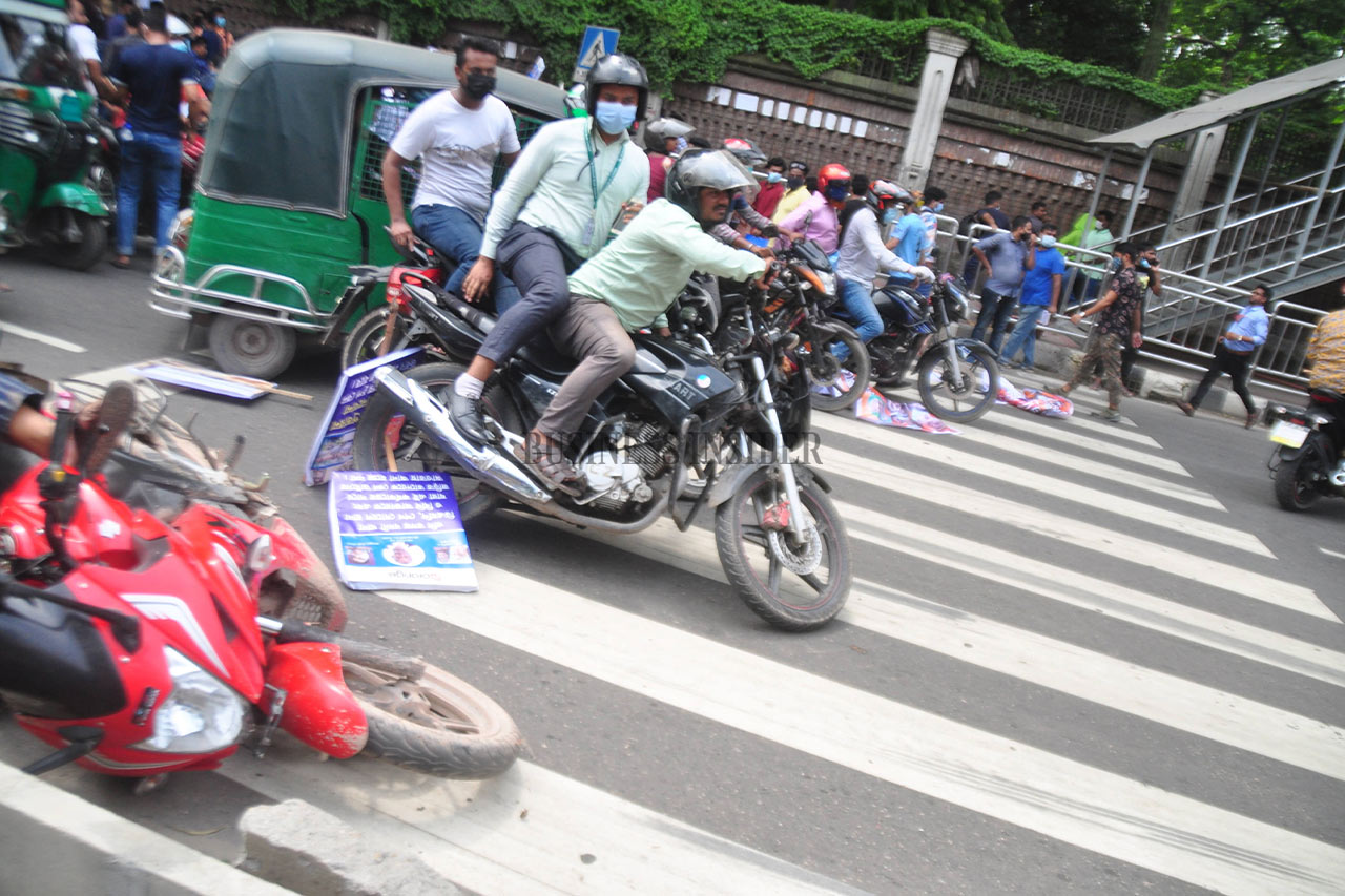 Motorcyclists block an intersection
