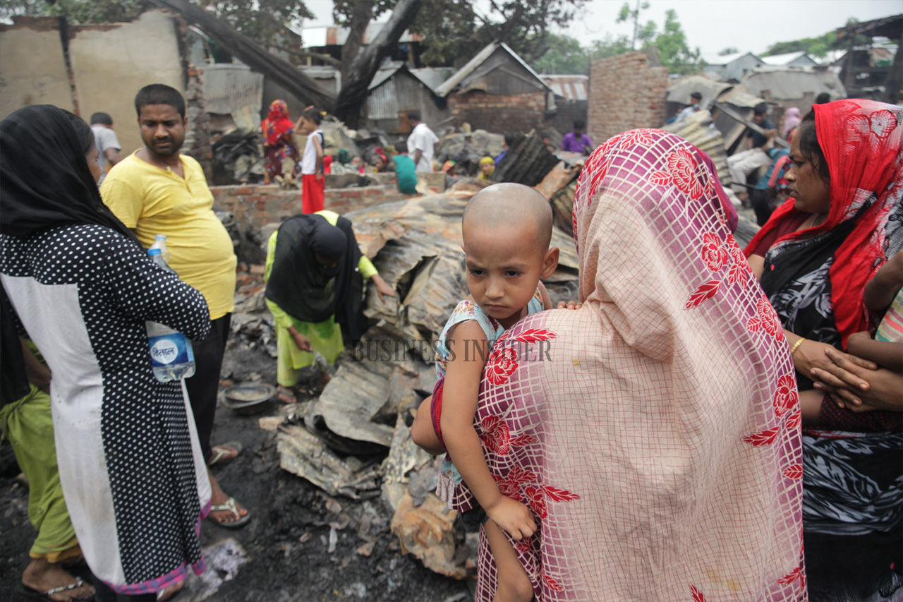 People look with uncertainty at the debris