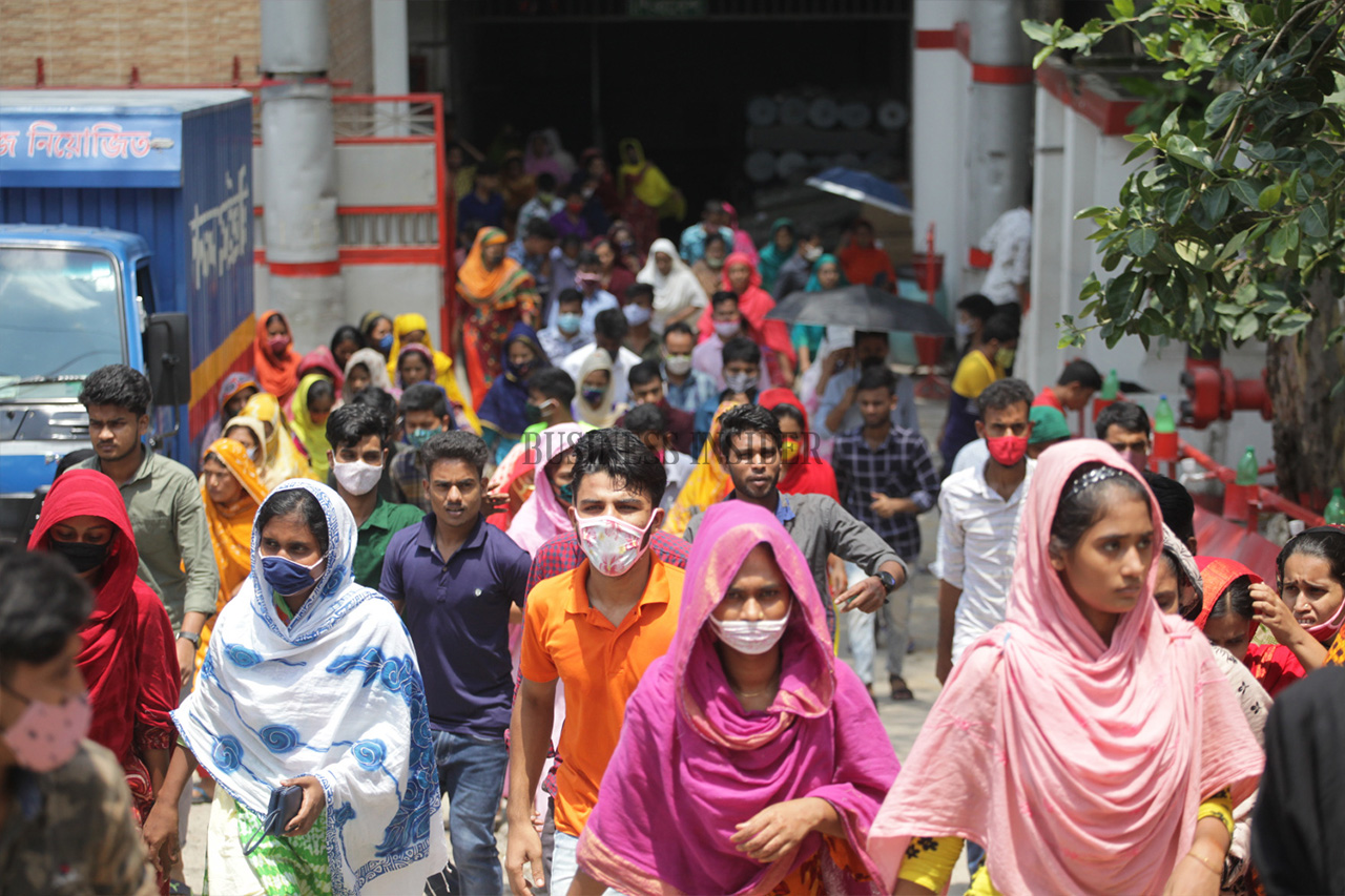 Garment workers leaving their factory after work