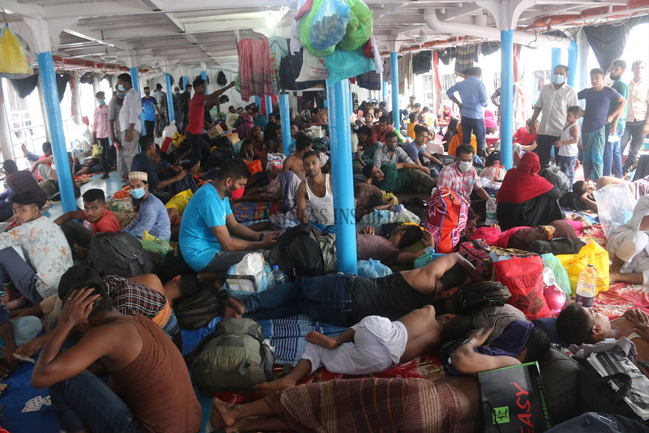 Homebound people are jam-packed on a deck of a launch. No social distancing, no mask.
