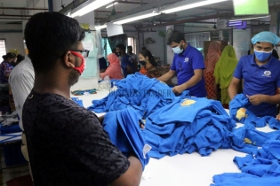 In Pictures: Garments workers work during the pandemic