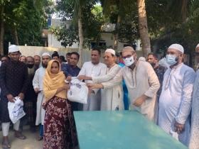 Shahjalal Islami Bank distributes relief among poor at Nawabganj