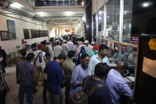 In Pictures: Customers rush to withdraw money before Eid