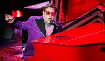 Sir Elton John scores first number one in 16 years