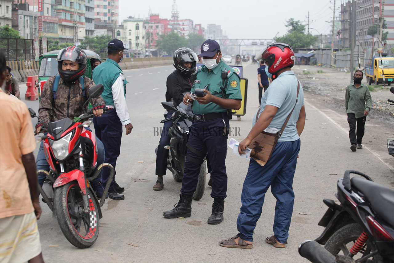 Police check a few riders movement pass