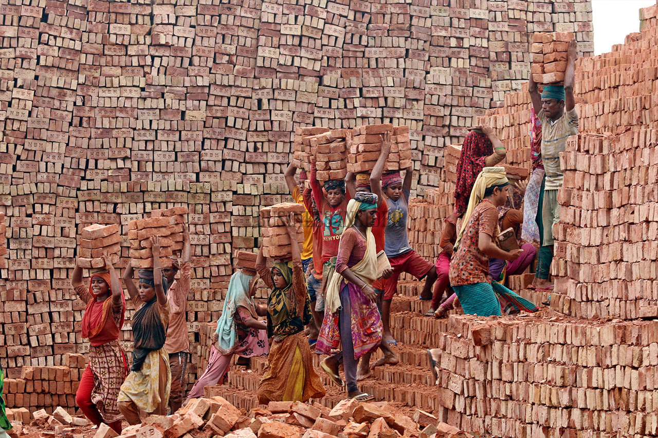 Men, women and children of all ages labourers working in the brickkiln