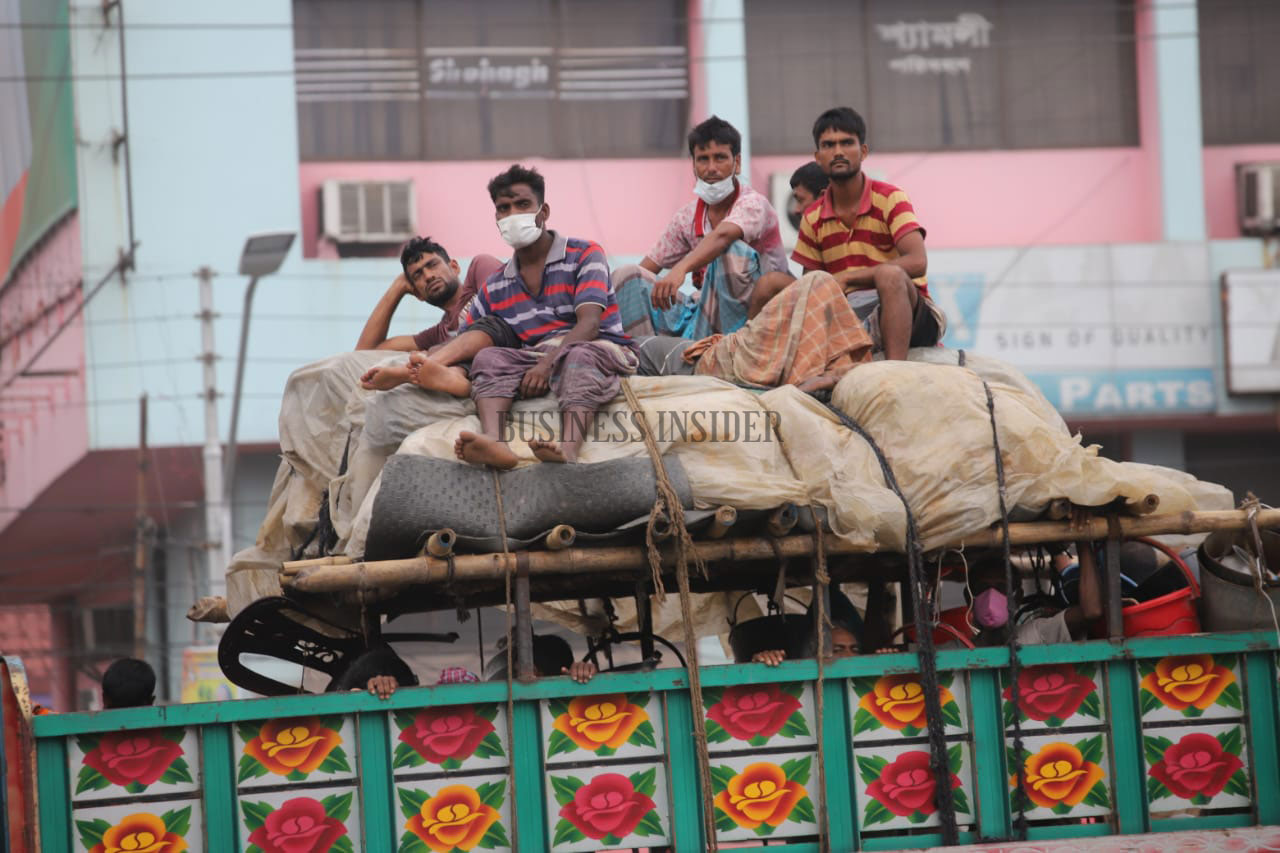 Low-income people are seen leaving Dhaka by goods carriers, such as pickup van and trucks, in jam-packed