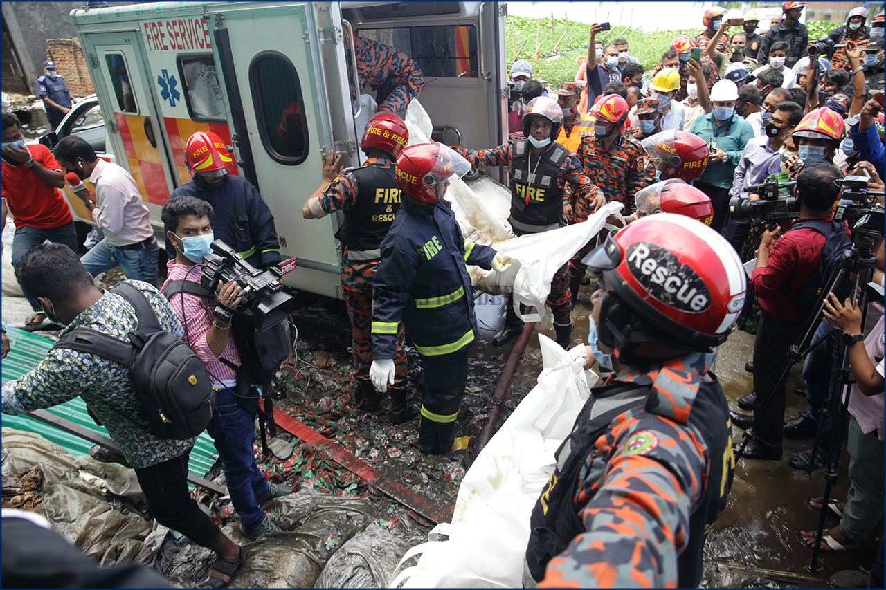 Firefighters and rescue workers recover the bodies of the deceased