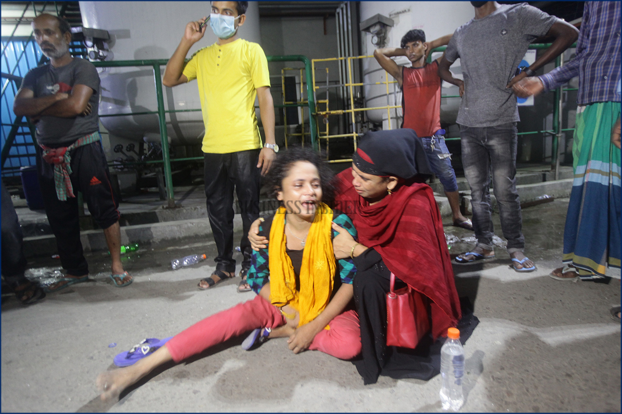 A relative of the victim mourns at the site after the fire broke out
