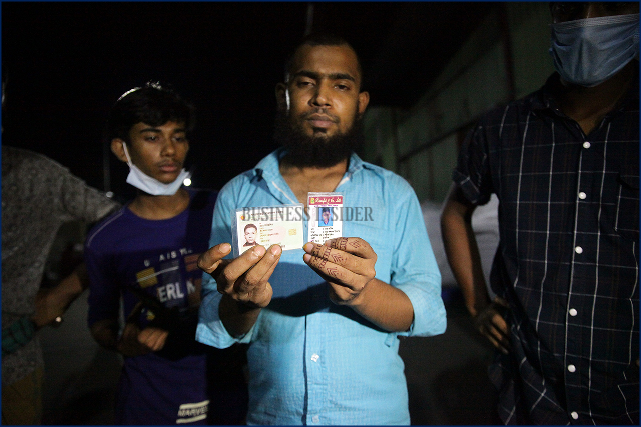 A man is searching his relative holding an identity card where the fire broke out