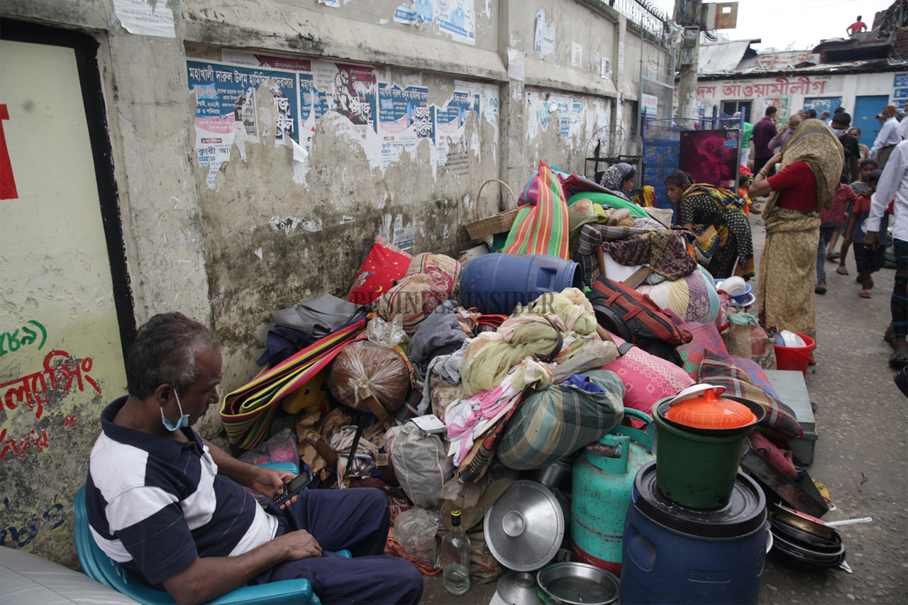 People gather their belongings left from the fire