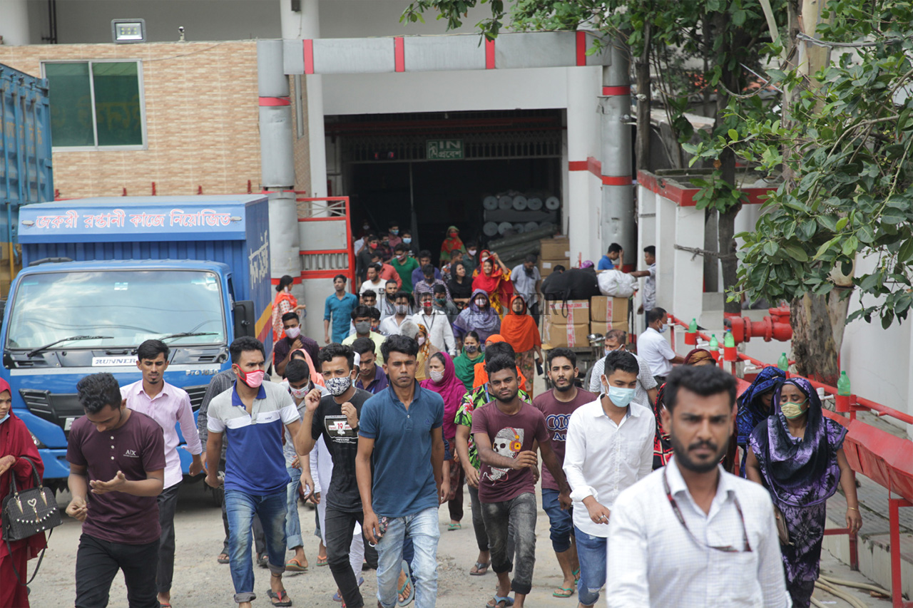 Garment workers are seen not maintaining social distancing