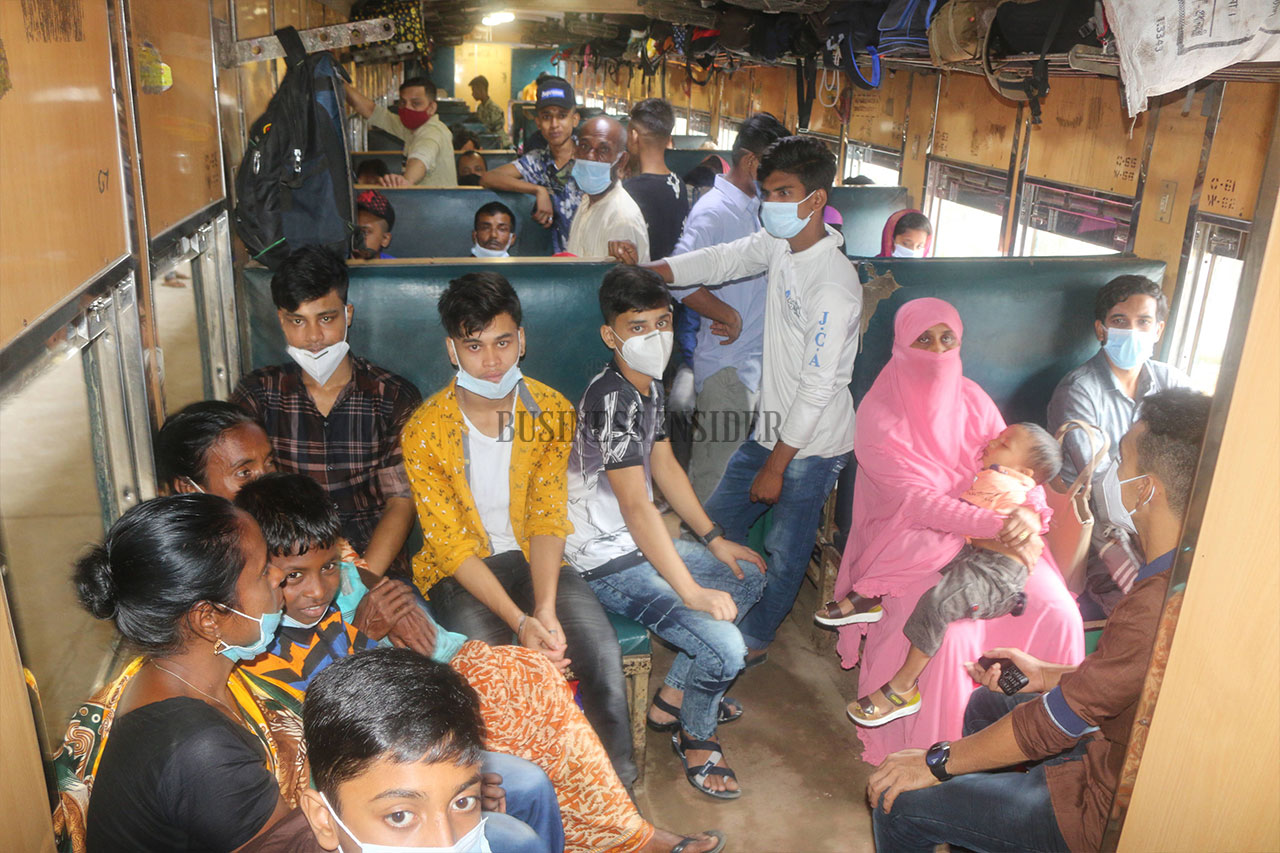 Passengers in a train are seen they have the masks, but not used properly