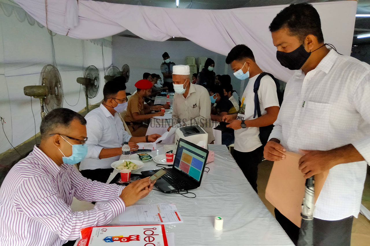 Students wait at the vaccine registration booth
