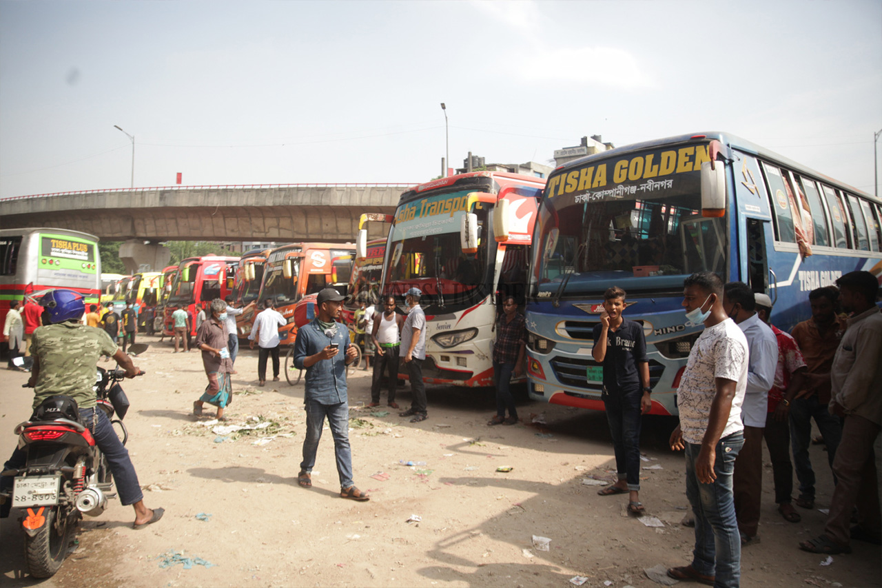 Buses are  waiting at a terminal to leave Dhaka